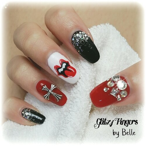 Manicure + Hand Drawn + Hand Painted + Studded + Gel Art + Manicure Art + Sg Nails + Pretty Nails + Rolling Stone Nails + Cross Nail Art + Gel Patterns + Gel Design + Red Nails + Black Gel Nails + Shiny Nails