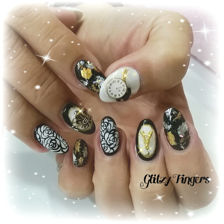 nails + nailart + nailstagram + naildesigns + sgnails + prettynails + gelnails + nailartoftheday + gelish + gelishnails + nailgasm + sgignails + singaporenails + pinkroomnails + angelpronail + cutenails + manicure + angelprogelly + sgig + nailfashion + nailartist + potd + black and white nails + gold nails + shiny nails + studded nails + paris nails + eiffel tower + foil nails + silver nails + alice in wonderland nails + disney nails +